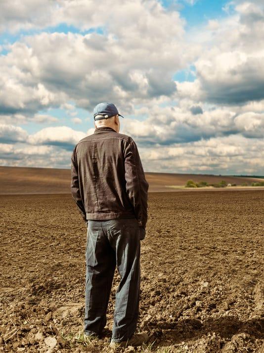 farmer on spring field