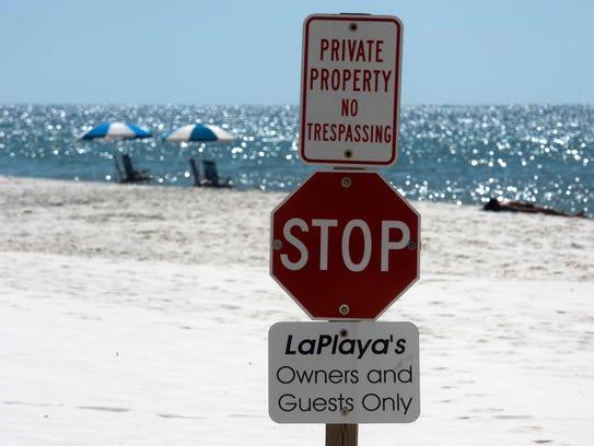 No trespassing signs line Perdido Key on Tuesday, April