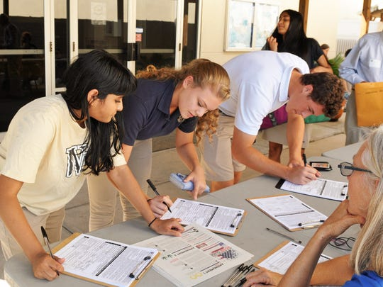 Nadia Kumar-Agarwal, 16, Julie Spicer, 16, and Brandon Schwab, 17. With the help of the League of Women Voters,students under 18 pre-registering to vote at Holy Trinity Episcopal Academy upper campus in Melbourne. 18 year olds could register to vote, as well.