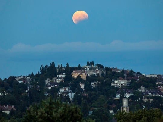 A partial lunar eclipse above the 2nd district of Budapest, Hungary.