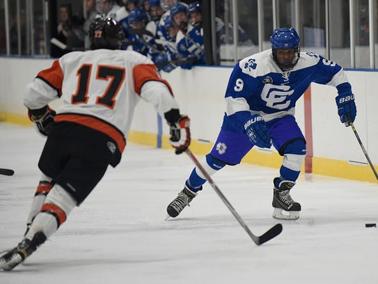 Catholic Central's Ryan Clemons (9) moves the puck