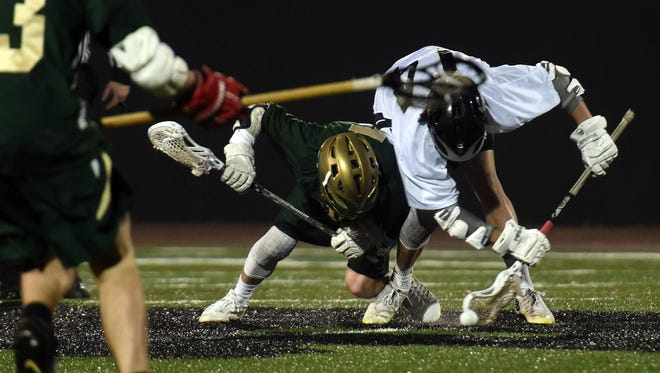South Western's Tyler Dunn, right, goes after the ball on a face-off, Tuesday, April 3, 2018. The York Catholic Fighting Irish beat the South Western Mustangs, 16-6.