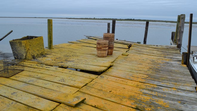 The dock owned by Ed and Maxine Landon in Rhodes Point, Smith Island, has been battered by Hurricane Sandy and other storms.