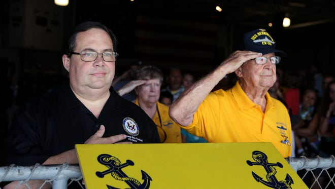 U.S. Rep. Blake Farenthold (left) , R-Corpus Christi, and WWII survivor Bob Batterson stand at attention following the release of a wreath into the Corpus Christi Bay during a commemoration and wreath laying ceremony at the Lexington Museum on the Bay on Monday, May 29, 2017 in observance of Memorial Day.