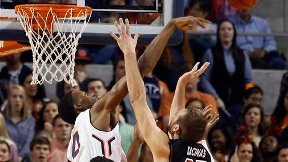 Auburn's Trayvon Reed blocks the shot of South Carolina's Mindaugas Carrera during the first half of an NCAA college basketball game on Saturday, Jan. 17, 2015  in Auburn, Ala. Auburn has announced Reed will not be returning to the Tigers men's basketball program.
