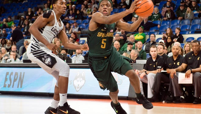 Michigan State guard Cassius Winston drives past Connecticut's Christian Vital for a basket during the second half Friday night at the PK80 Invite in Portland, Oregon. Winston finished with 28 points, 23 in the second half.