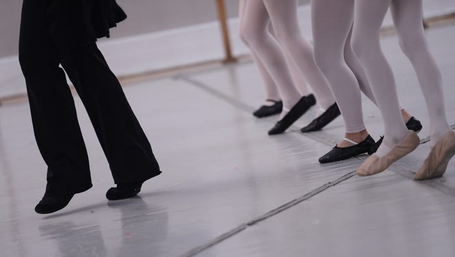 """ESO Dance instructor Dana Floyd Sutter, left, leads her dancers through a routine for the upcoming ESO production of """"The Nutcracker Swings"""" during class in Belle Haven, Va. on Wednesday, Dec. 9, 2015. This year's production marks the 25th anniversary of the dance company's holiday tradition."""