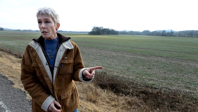 Anne Goetze stands along Coleman Road on Wednesday, Dec. 7, 2016, in Thompson Station, Tenn., where a proposed sewer plant is going to be built on farm land behind her.