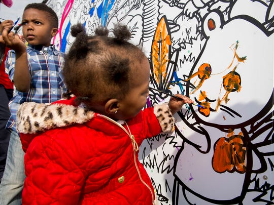 Corey Parker, 4, of River Rouge, left,  and his sister,