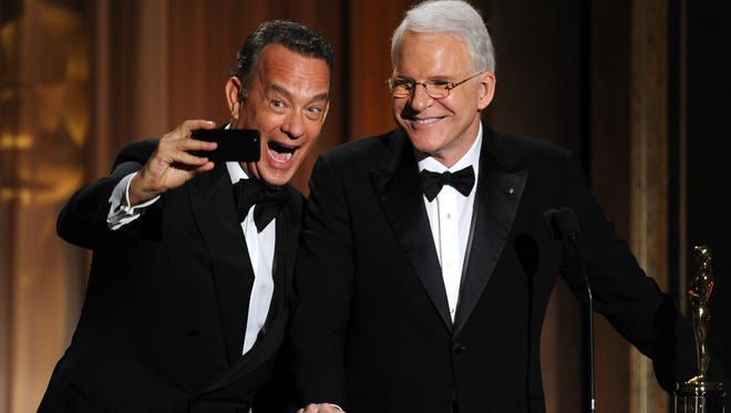 Tom Hanks presents Steve Martin with an honorary award at the Academy of Motion Picture Arts and Sciences' Governors Awards.