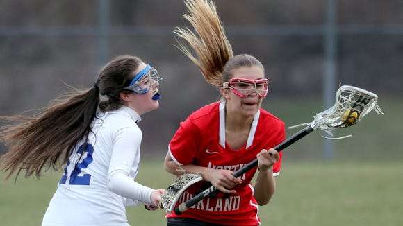Ashley Morales of North Rockland controls the ball while being pressured by Mary Kate Henry of Pearl River during a varsity girls lacrosse game at North Rockland High School April 6, 2018. North Rockland defeated Pearl River 16-2.