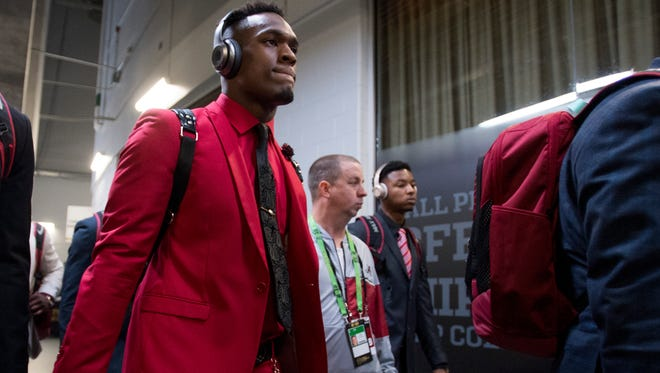 Alabama linebacker Mack Wilson (30) arrives with the team before the College Football Playoff National Championship Game in the Mercedes Benz Stadium in Atlanta, Ga., on Monday January 8, 2018.
