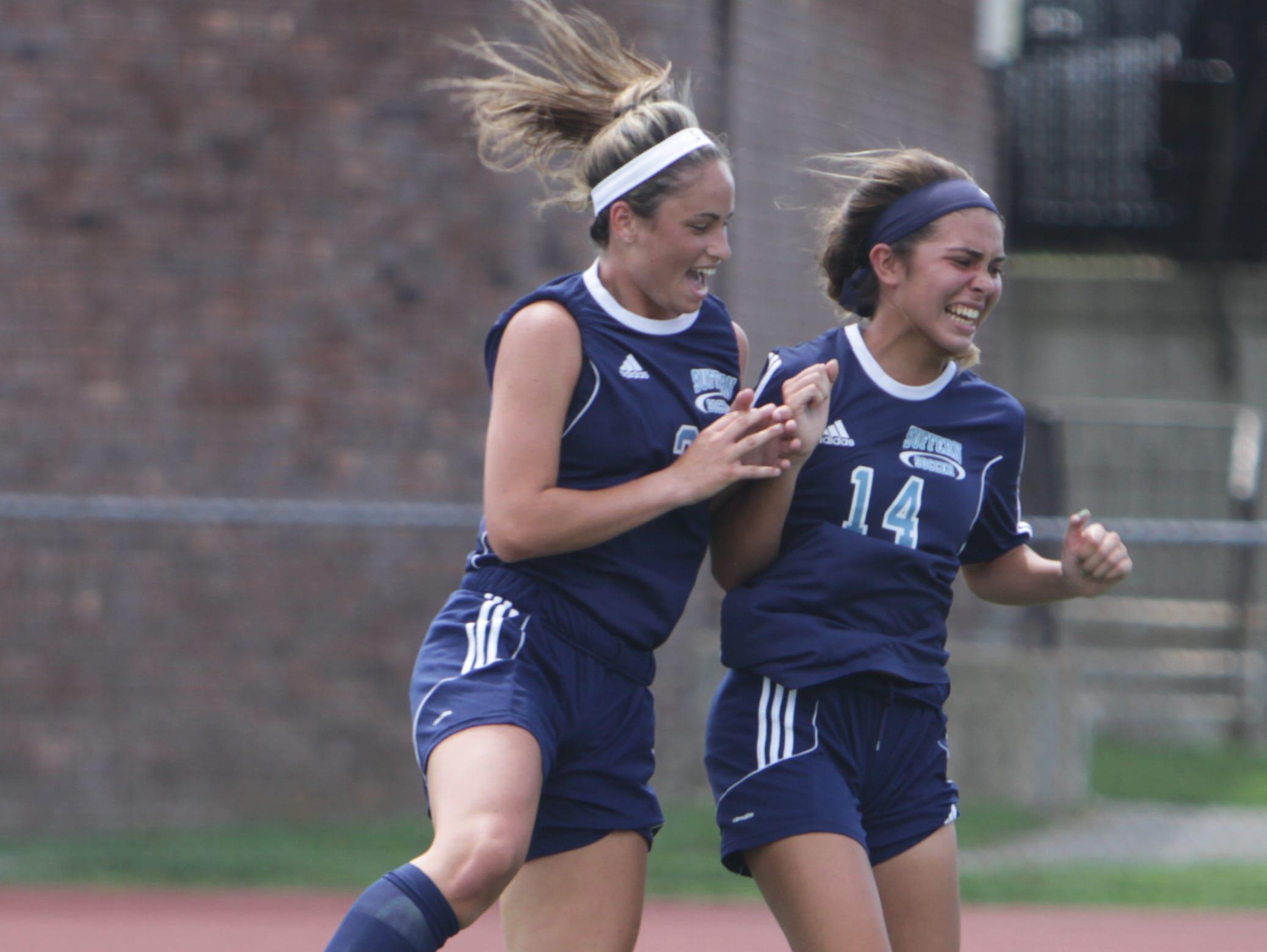 Suffern's Kyra Greenbaum (left) and Tatiana Cruz celebrate after Greenbaum's first half goal during a Section 1 girls soccer game between New Rochelle and Suffern at New Rochelle High School Friday, Sept. 2. Suffern won 4-1.