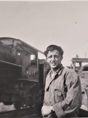 Pfc. Edmund D'Attelo at work as a yardmaster supervising troop and cargo trains in Alaska during WWII.