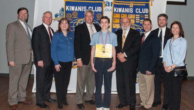 Michael Goss, center, is named the winner of the Regional Kiwanis Spelling Bee.