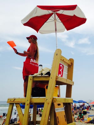 Lifeguard Caitlyn Bunting watches over swimmers Friday at Assateague State Park.