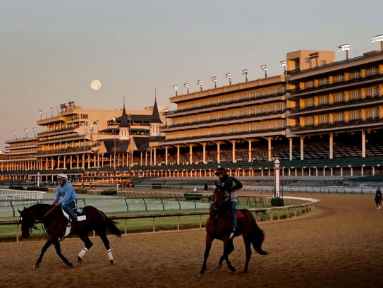The full moon sets beyond the grandstands at Churchill