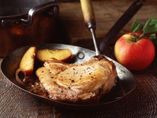 Pork chop sauteed with apple and onions, a popular