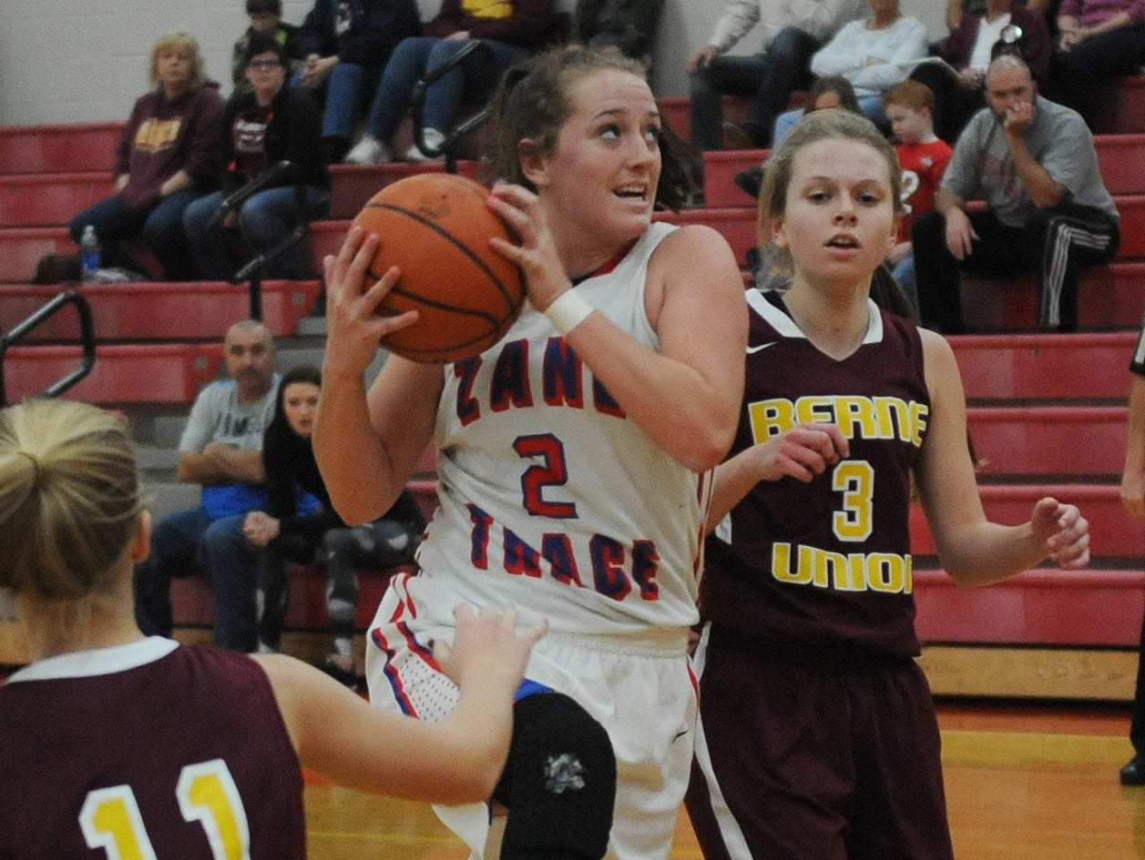 Zane Trace's Kaitlyn Unger jumps up for a shot against Berne Union Friday at Zane Trace High School.
