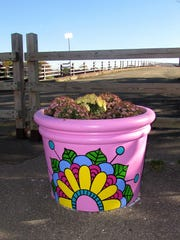This planter at the north end of the Lake Street bridge is one of many examples of public art on display in the City of Elmira.