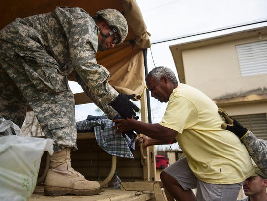 National Guard personnel evacuate Toa Ville resident