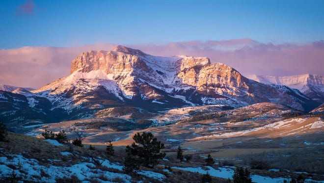 A pink-and-purple sunrise along the Rocky Mountain Front is included in a new photo book about the area.