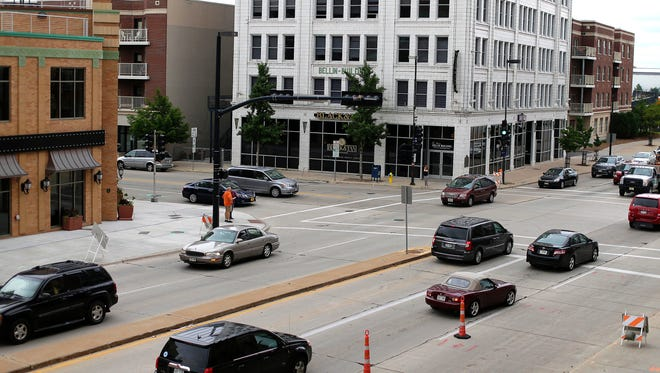 Traffic moves along Friday near the intersection of Walnut and Washington streets in downtown Green Bay.