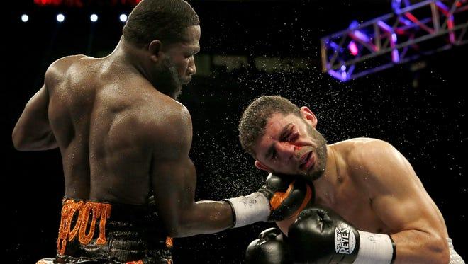 Cincinnati's own Adrien Broner, left, lands an uppercut punch on the chin of Khabib Allakhveriev in October at US Bank Arena.