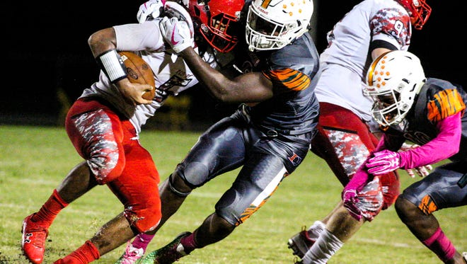 North Fort Myers' Fa'Najae Gotay is wrapped up by Dunbar's Bakari Jackso as he gained yards. Game highlights from the North Fort Myers at Dunbar football game.