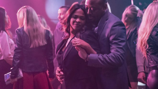 """This image released by Netflix shows Nia Long, left, and Omar Epps in a scene from """"Fatal Affair."""""""