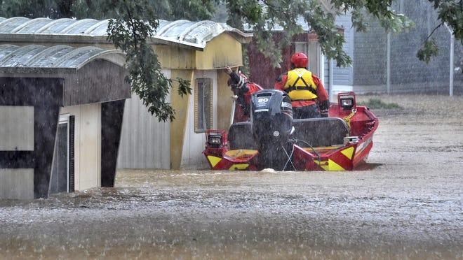 Rescuers check a flooded mobile-home park Friday, Aug. 31, 2018, just off Route 230 east of Mount Joy. (Blaine Shahan/LNP/LancasterOnline via AP)