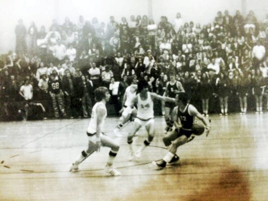 Gabriel, center, was a team captain on Delone Catholic's 1974 state championship team. Twenty-five years later, he was named the best executive in the NBA.