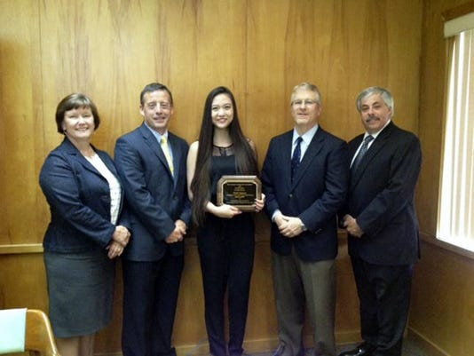 Trinh Nguyen has been named the 2015 Outstanding Senior of the Year by the Lebanon County Bar Association and WLBR/WQIC. Presenting the award to Trinh Nguyen (center) are, from left, Ann Kline, John Ditzler,  Marc Hess, and Robert Etter, president and general manager of WLBR/WQIC. The 2015 Cedar Crest High School graduate plans to attend the University of Pittsburgh to study business and marketing. From nominees offered by each of the countyâ  s school districts, this award seeks to recognize one outstanding senior for his or her accomplishments both in and out of the classroom.  Each county school district nominates one senior and the committeeâ  s job is never easy since all of the nominees are typically outstanding.  Nevertheless, there can only be one award recipient and the committee seeks to honor the senior which it believes stands out among the best and brightest. Submitted