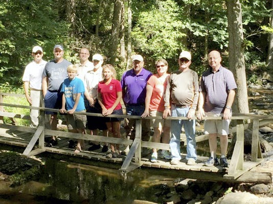 Pictured, from left, are: Scot Pitzer, legislative aide to Senator Alloway; Marty Karsteter Qually, Adams County commissioner; Qually's son Lucien; Adam McClain and Larry Martick, of Adams County Conservation District; Chris Kimple, legislative aide to Representative Moul; PA State Rep. Dan Moul; Holly Sutphin, legislative aide to Representative Perry; Dave Swope, of Adams County Trout Unlimited; and PA State Rep. Will Tallman.