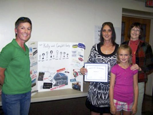 Mentor Ally Mimi Walker, Circle Leader Jen Kelly, her daughter Payton and mentor Ally Marilyn Baker last week celebrated Kelly's completion of  the Palmyra Circles of Lebanon County, a two-year program designed to help individuals - the Circle Leaders - become economically self-sufficient.  Submitted