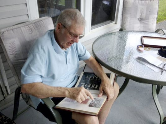 Lower Windsor Township Robert Miller looks through his scrapbook with articles and photos from his playing days at Wrightsville and Eastern York High Schools. Miller was on the York County Scholastic League basketball championship team at Wrightsville in 1955 and Eastern in 1956. Steve Navaroli -- Daily Record/Sunday News