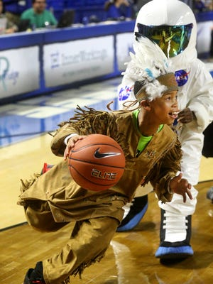 Brazton Caruthers, a sixth-grader at Black Fox  Elementary dribbles around E.J. Turner of Hobgood Elementary as the two play in a mascot game of basketball during half-time of the MTSU Lady Raiders Education Day game against Missouri State on Thursday.