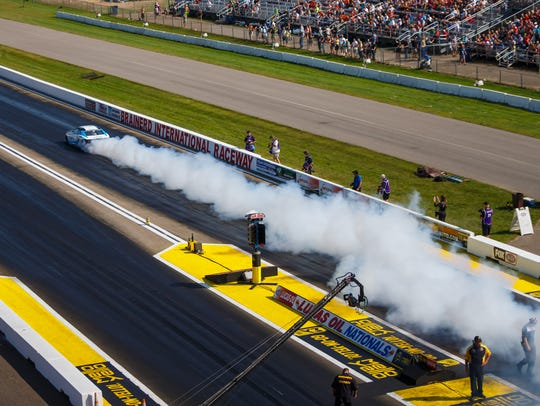 NHRA pro stock driver Shane Gray does a burnout during