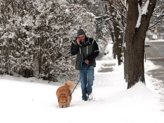 Alex Weil walks with Truman along a snowy Macculloch
