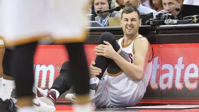 Cleveland Cavaliers center Andrew Bogut (6) lays on the floor after being injured during the first half against the Miami Heat at Quicken Loans Arena.