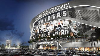 This artists's rending shows the exterior of revised plans for a proposed stadium that would house both the Chargers and the Raiders in Carson, Calif.