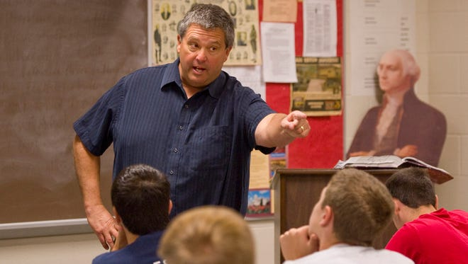 Paul Rynkiewich calls on a student during their discussion in his honors U.S. history class at North Posey High School.