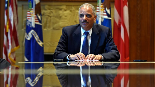 Attorney General Eric Holder speaks during an interview at the Justice Department in Washington, D.C., om Tuesday, Sept. 16, 2014. Broadening its push to improve police relations with minorities, the Justice Department has enlisted a team of criminal justice researchers to study racial bias in law enforcement in five American cities and recommend strategies to address the problem nationally, Holder said.