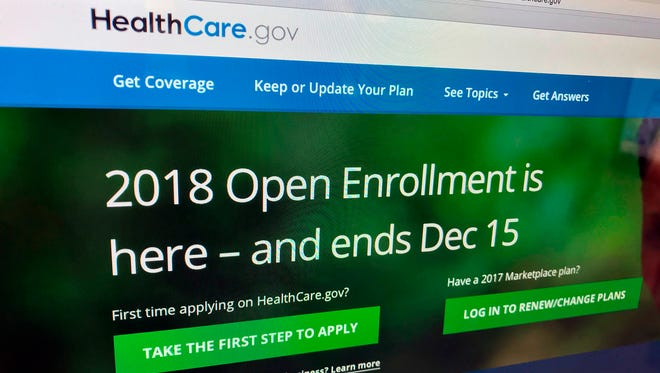 In this Dec. 15, 2017, file photo, the HealthCare.gov website is photographed in Washington. Funding decisions the Michigan Legislature made as it expanded Medicaid have led to a funding shortfall in the state.