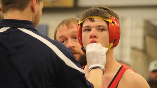 Purcell Marian's Jake McCarthy gets his lip checked in a semifinal at 145 pounds at the Madeira Invitational last January.