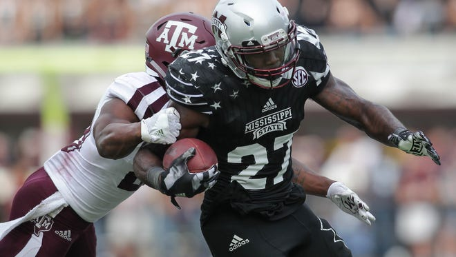 Most prognosticators still have Mississippi State running back Aeris Williams, seen here runing for a first down against Texas A&M defender Clifford Chattman, and his teammates staying at home for bowl season.