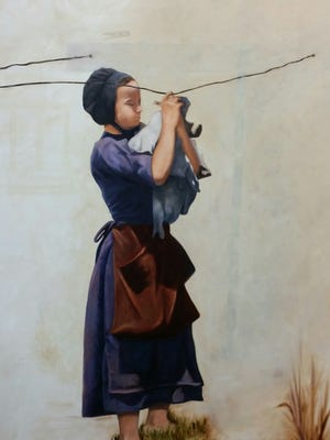 """The Willicey Tynes piece titled """"Days Gone By"""" represents a little girl from Harmony carrying out her household chore of washing and hanging clothing."""