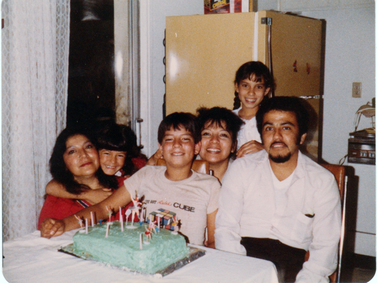 A young Henry Magos with his family in an undated photo.