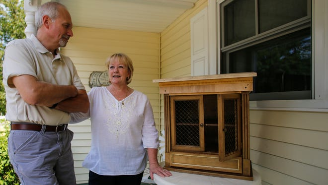 Rick and Kim Klatt of Grand Ledge with the  prototype of their little free pantry in progress.    They hope to replicate the little free pantry concept that has had success in Fayetteville, Arkansas.  [MATTHEW DAE SMITH/Lansing State Journal]