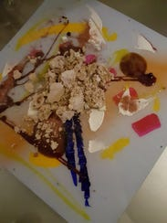 A climactic dessert course at Chicago's Alinea is eaten